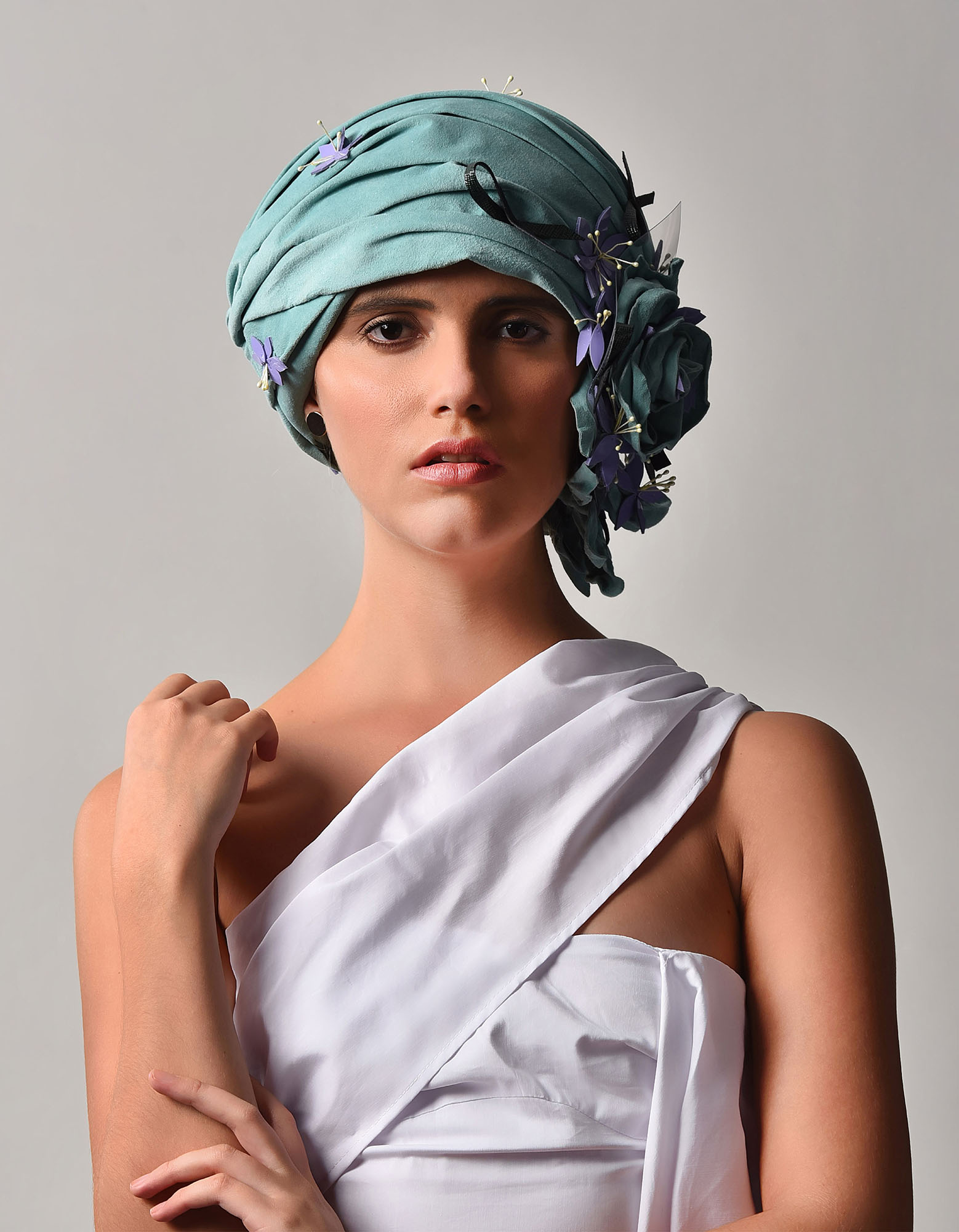 Aqua suede turban with lavender patent flowers and forest green leather twists.